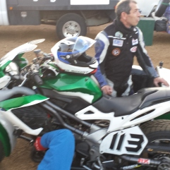 Les Marluches putting final touches on their rebuilt Benelli sidecar. Photo: Kate Kriebel
