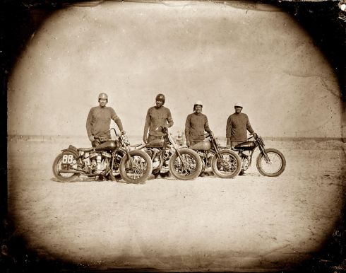 modern tintype picture of motorcycles and their riders on the beach