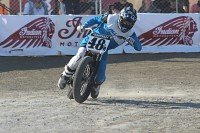 flat track racing motorcycle exits a corner