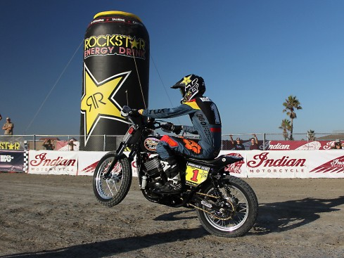 Harley motorcycle hooligan racer doing a wheelie