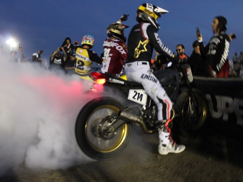 motorcycle racers do burnouts for a crowd
