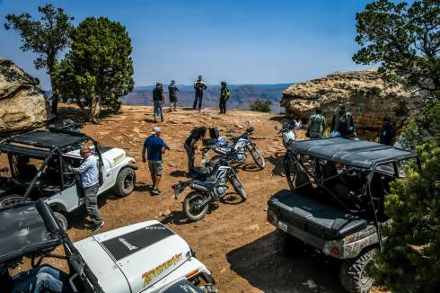 adventure veterans on a mountain lookout with motorcyles, UTV side by sides, and ROXOR off road vehicles.