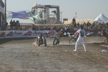 motorcycle flat tack racers sliding sideways across finish line
