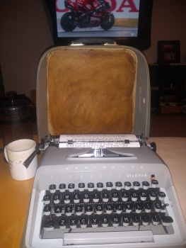a portable remington typewriter on a table