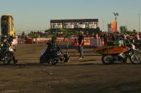 motorcycles racing flat track on asphalt