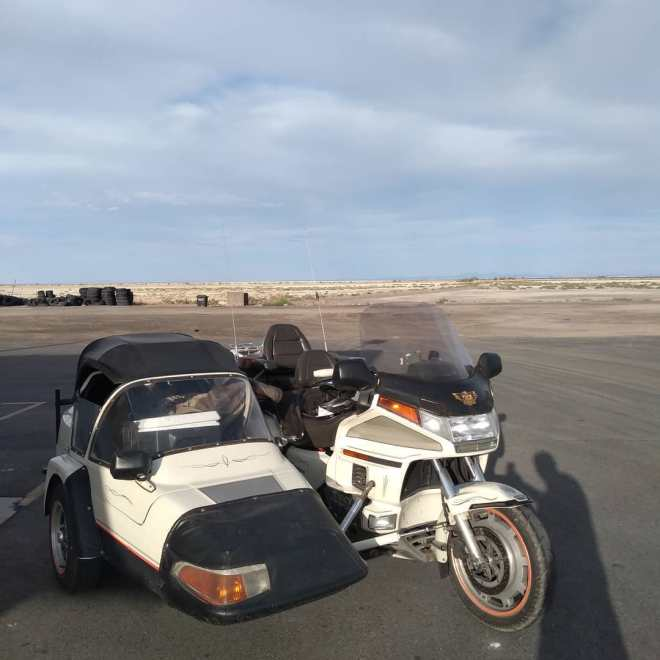 a honda motorcycle sidecar parked on a road